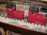 Image of two small battery powered diesel locomotives
