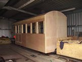 Image of an unfinished carriage in the shed